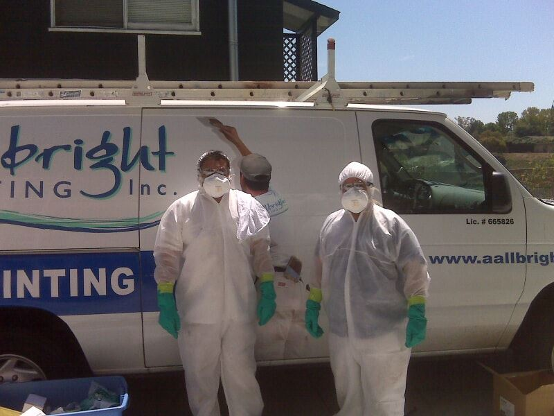 two ALLBRiGHT Employees in front of company van