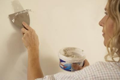 person preparing room to paint